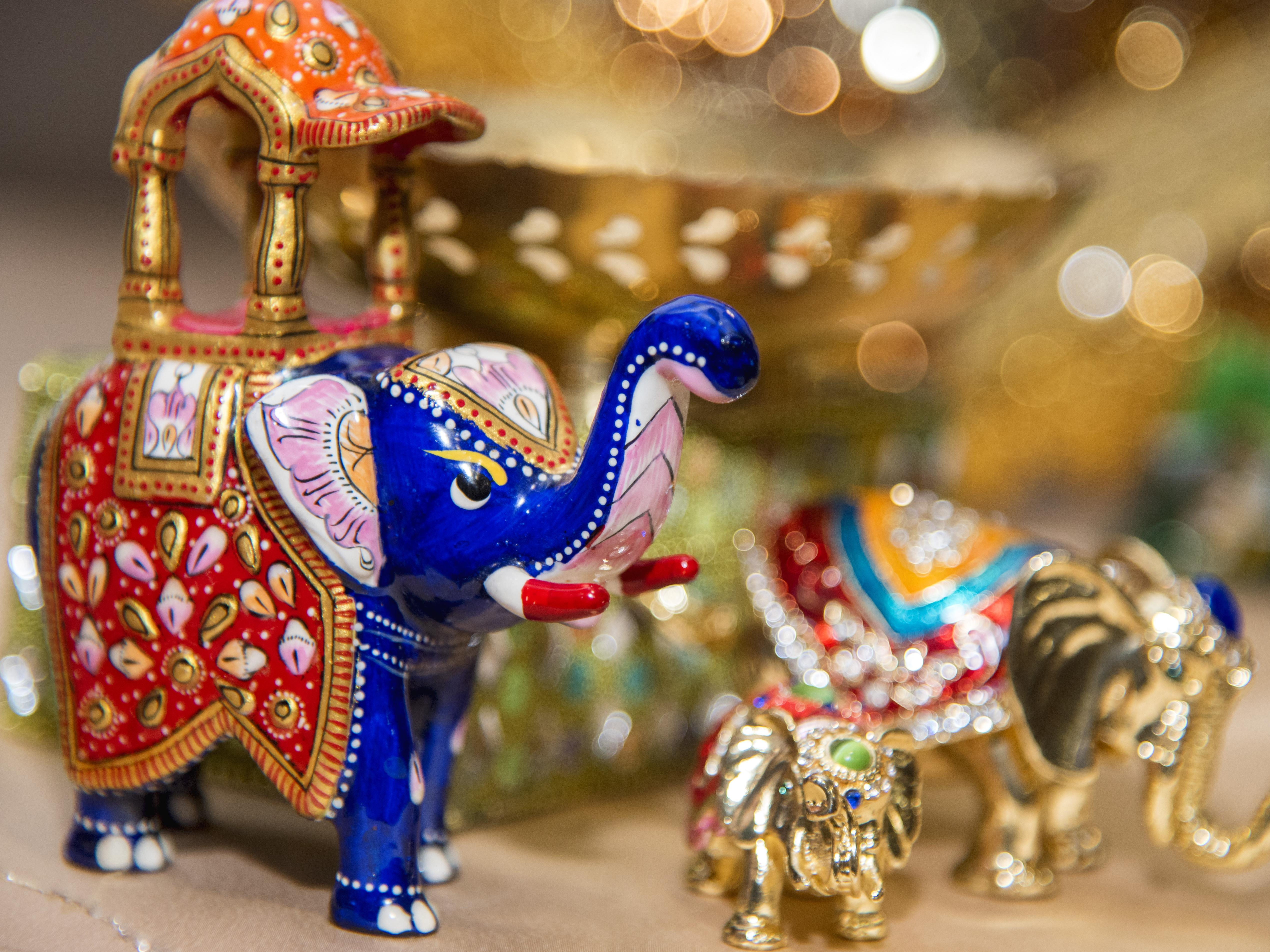 Photograph of brightly colored of Indian elephants
